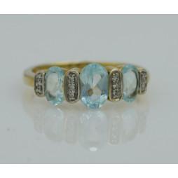 Pierścionek złoty Topaz błękitny + diamenty