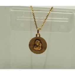 Medalik złoty M. B. C.